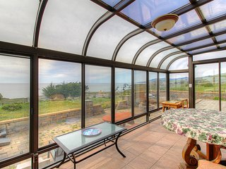 Oceanview home w/ incredible views, sunroom, courtyard - near beaches/trails!