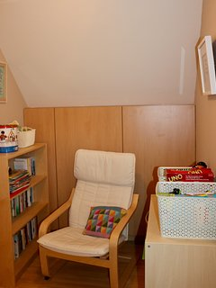 Upstairs reading corner with toys and games