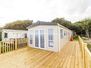 6 berth caravan with D/G, C/H, decking and full seaview. *Pets allowed.REF 32069