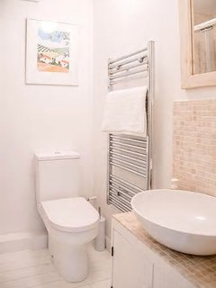 Shower Room with heated towel rail and modern sink.