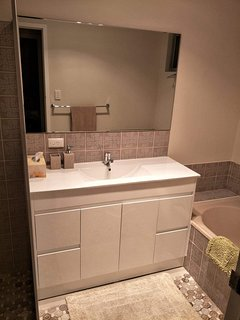 Family Bathroom with vanity, bathtub and separate shower. Toilet is separate from the bathroom.