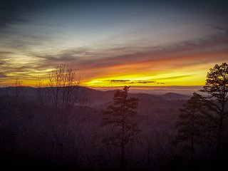 Stunning sunsets from the back deck or looking out from the Great Room.