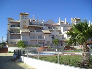 Apartamento a pie de playa con piscina y terraza