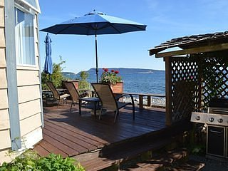 Beachfront Duplex Cottage walk on waterfront large deck sits seawall Adults only