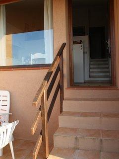 scala esterna che dal terrazzo vista mare conduce all'interno della sala da pranzo