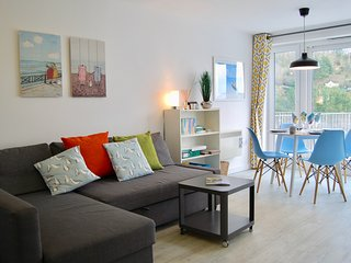 Comfortable contemporary living with a pull out sofa to relax on.