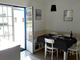 Cuisine/salle à manger, accès direct a la terrasse