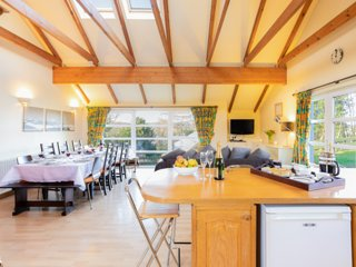 A capacious kitchen-living area with stunning views - ideal for entertaining large groups of friends