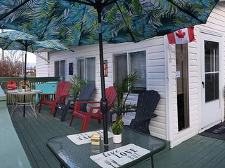 Huge deck overlooking a walk path that leads to the Old Casino. BBQ & rolled ice cooler/50s theme