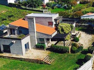 Casa de lujo en Sanxenxo,frente a islas Ons y Cíes,2000m2 jardín,wifi gratis