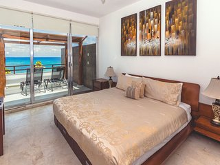 Master suite with king bed, TV and ocean view