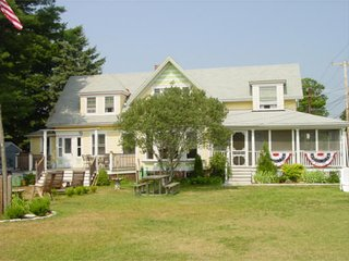 Steps to beach, large yard, sleeps 13, walk to town, washer/dryer