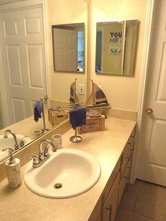 Fully equipped bathroom with bath towels, hair dryer and straightener