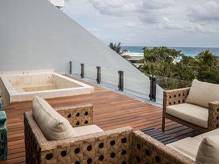 State of the art 2 Br condo beachfront, private pool