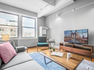 Loft-like + Roomy Dumbo Studio w/ Office, Doorman by Blueground