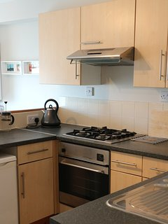 Fully equipped kitchen with complimentary tea, coffee and cereals