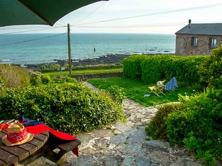 Gorgeous sea facing terraced cottage moments from the beach