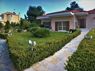 Villa BELLEZZA with a large yard and BBQ