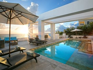 Villa Tasha, a luxury seafront villa on the Caribbean sea, next to a beach