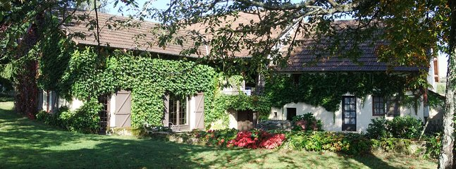 Cottage with its ivy covered stone walls from the yard