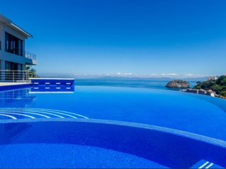 Stunning Villa with views to the ocean , jungle , full staff ,pool