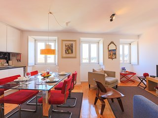 A stylish and bright lounge with an open kitchen and an amazing view of the City and the Castle