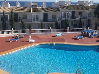 Beautiful modern apartment with pool and sea views close to all amenities