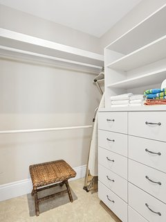 spacious walking closet features plenty built-in cabinets and drawers