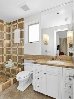 elegant ensuite bathroom decorated with marble and limestone