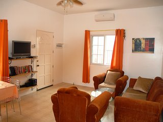 Lounge has comfortable seating for 5 with the TV and entertainment centre in front