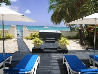 Single story beach front villa in St James with jacuzzi tub