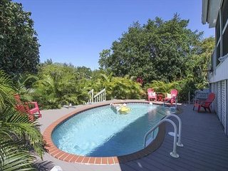 Coastal Serenity: Secluded WestEnd Oasis Pet-friendly Pool Home on the Canal!