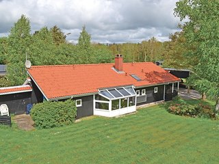 Awesome home in Oksbol w/ Sauna, 4 Bedrooms and WiFi
