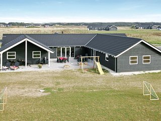 Awesome home in Lokken w/ Sauna, WiFi and 8 Bedrooms (D7250)