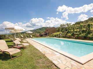 Zonnig landhuis met uitzicht op Volterra (ITP472)