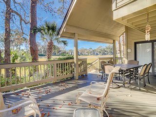 Two-story villa with a shared pool, tennis courts, and an easy walk to the beach
