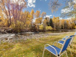NEW LISTING! Riverfront home w/gorgeous setting - near fishing/golfing