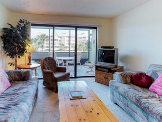NEW LISTING! Waterfront condo w/pools, tennis courts, a fitness center & marina