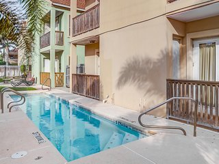 Family condo with a balcony, shared pool, and full kitchen, steps from the beach