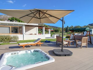 Bright villa w/ modern touches - private hot tub, furnished terrace, & views