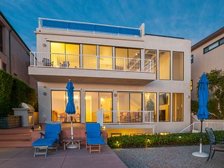 Listen to the waves from this oceanfront home with a private hot tub!