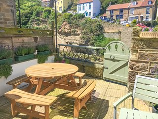 Relax on the patio overlooking the beck