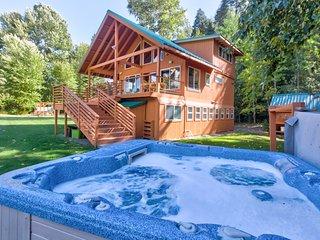 Riverfront home w/ private hot tub, views & modern amenities!