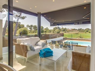 Enjoy a private pool & beautiful outdoor spaces at this stunning island villa!