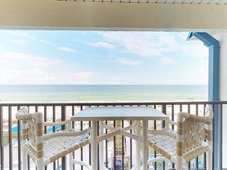 Stylish oceanfront escape with shared pool, sweeping beach views, and more!
