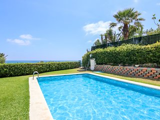 Oceanfront bungalow with shared pool, sea views, & easy beach access