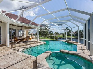 Stunning waterfront home on a canal w/ a dock and private pool!