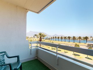 Escape to Cape Town at this condo w/ a full kitchen & balcony near the beach