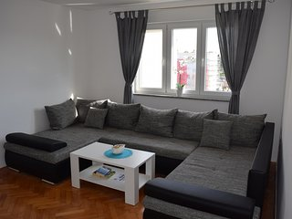 living room with large sofa and tv