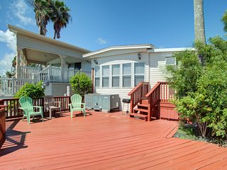 Bayfront Park Model Home w/ deck, shared pool, hot tub, gym, tennis, & golf